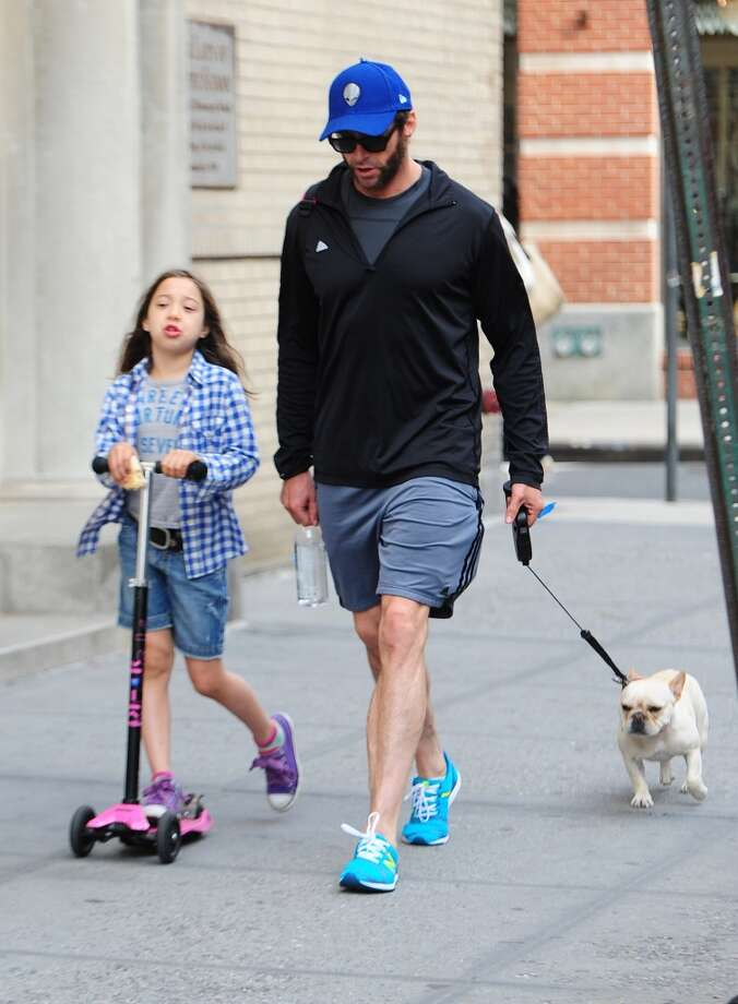 Actor Hugh Jackman and Ava Eliot walk home from school in New York City. Hugh also has a son, Oscar, with wife Deborra-Lee Furness. Photo: Raymond Hall, WireImage