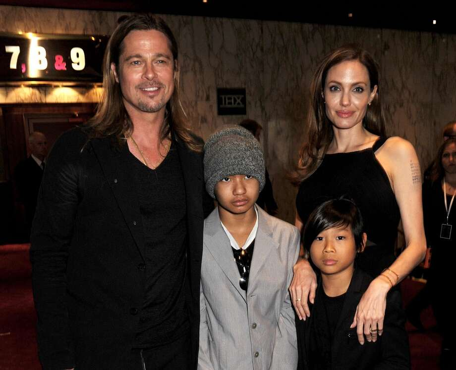 Brad Pitt, seen here with Maddox Jolie-Pitt, Pax Jolie-Pitt and wife Angelina Jolie, is also dad to Zahara, Shiloh, Knox and Vivienne. Photo: Dave M. Benett