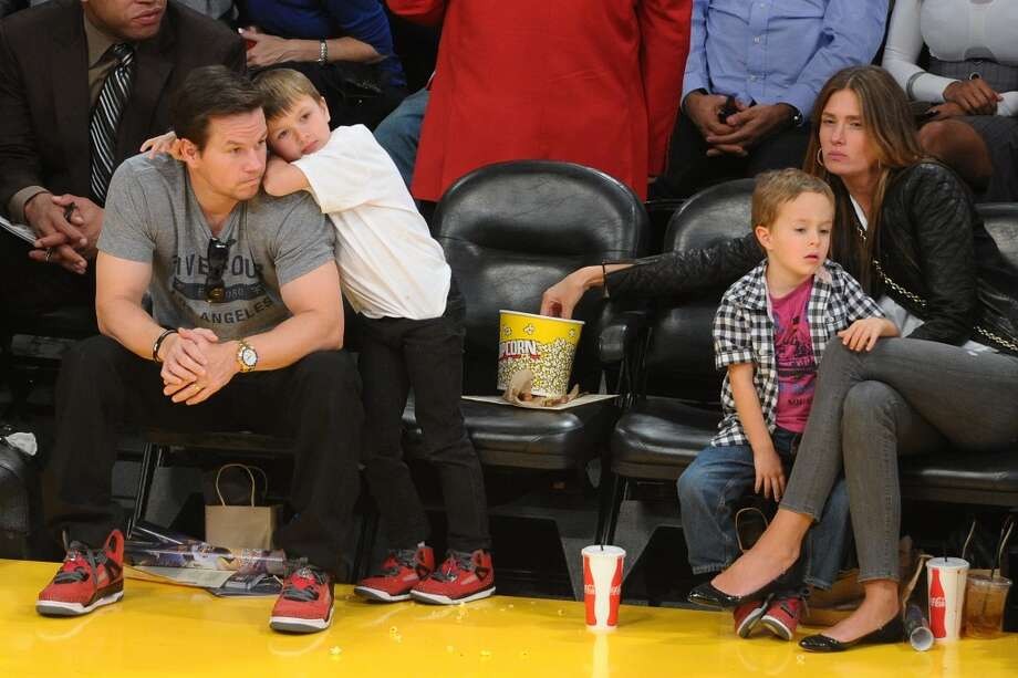 Mark Wahlberg catches a basketball game with sons Michael and Brendan  and their mom, Rhea Durham. The couple are also parents to two daughters, Ella and Grace. Photo: Noel Vasquez, Getty Images