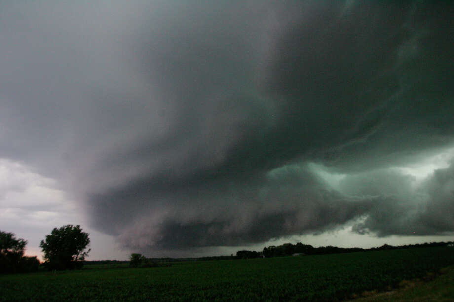 A wall cloud, containing a reported funnel cloud, passes over the Wanatah, Ind. area as a line of severe storm moves through the area Wednesday June 12, 2013. (AP Photo/The LaPorte Herald-Argus, Bob Wellinski) Photo: Bob Wellinski