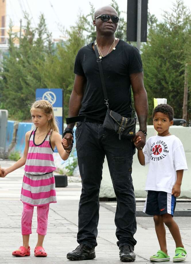 Seal, seen here with daughter Leni and son Henry Samuel, is also dad to son Johan and daughter Lou.