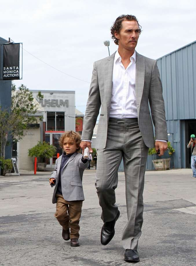 Matthew McConaughey takes a matching-jackets walk with son Levi. McConaughey and his wife, Camila Alves, are also mom and dad to daughter Vida and son Livingston.