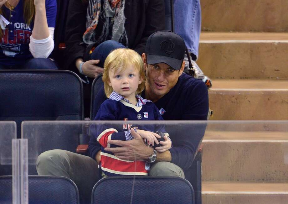 Actor Will Arnett and one of his sons attend the New Jersey Devils vs The New York Rangers game. He is dad to Archie and Abel with former wife Amy Poehler.