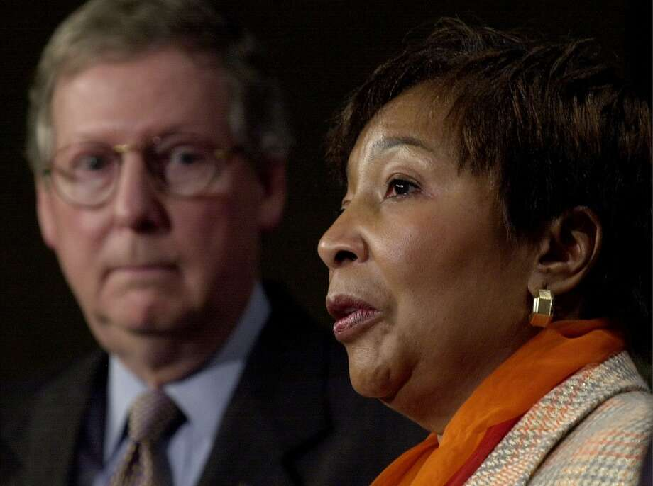 Rep. Eddie Bernice Johnson, right, D-Texas, chairwoman of the Congressional Black Caucus, speaks during a news conference in the Capitol. (AP Photo/Kenneth Lambert) Photo: KENNETH LAMBERT, AP