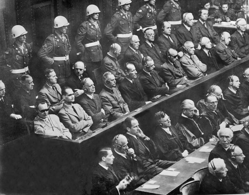 To go with story Cambodia-UN-trial-defence-Germany-WWII by Patrick Falby (FILES) In a file picture taken on October 1, 1946, 21 of the 22 Nazi leaders accused of war crimes during World War II listen to the prosecution at the Nuremberg court. From L to R: first row: Hermann Goering, Rudolf Hess, Joachim Von Ribbentrop, Wilhelm Keitel, Alfred Rosenberg, Hans Frank and . Second row: Karl Doenitz, Erich Raeder, Baldur von Schirach, Fritz Sauckel, Alfred Jodl, Franz Von Papen, Arthur Seyss-Inquart, Albert Speer, Konstantin Von Neurath and Hans Fritzsche. The 22nd defendant, Martin Bormann, was tried in absentia. Hitler's chief architect Albert Speer is set to play a posthumous role from November 19, 2009 when the trial of the main jailer for Cambodia's Khmer Rouge regime hears final arguments from lawyers. AFP PHOTO