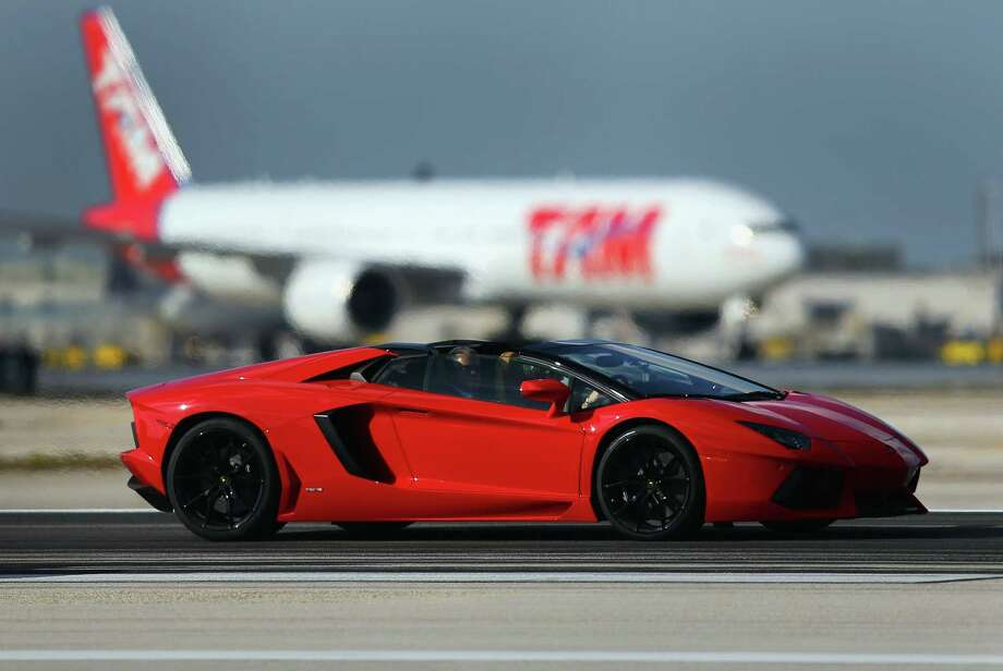 In case the Porsche is in the shop, he also owns a Lamborghini Aventador LP700-4 Roadster.  (Photo by Joe Raedle/Getty Images)Source:Yahoo Photo: Joe Raedle, File / 2013 Getty Images