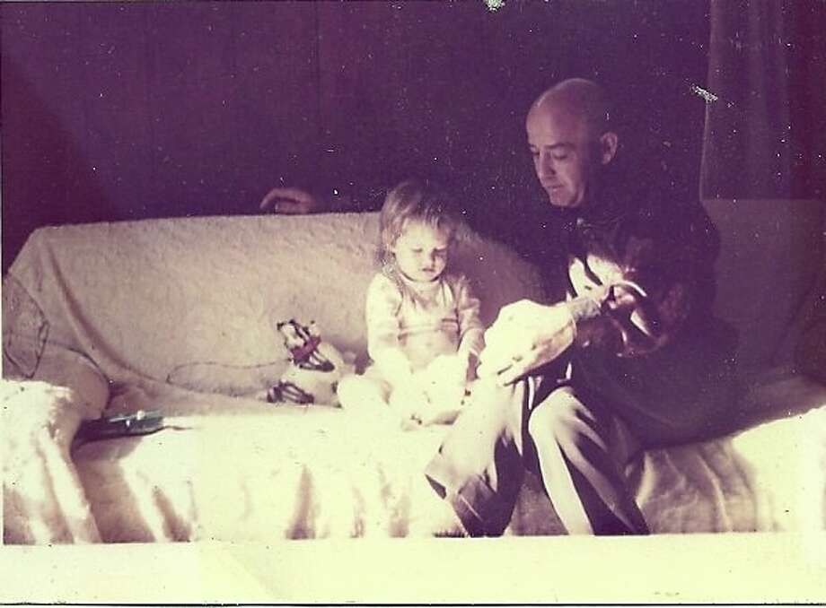 """""""This photo is about 50 years old! My dad was the most handsome bald headed man.""""  Photo submitted by: Jerrilynn Miller"""