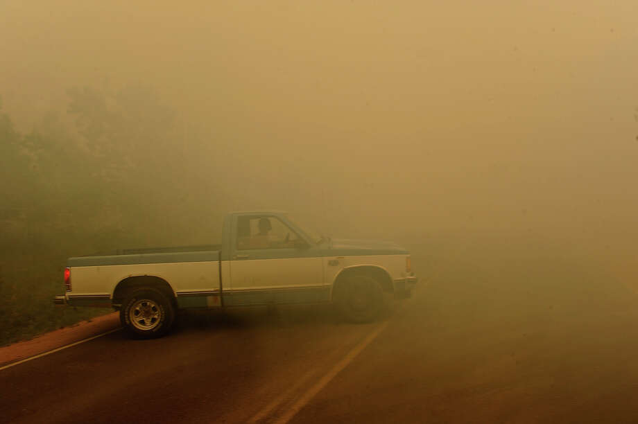 A man braves the smoke and heads into the fire in his pick up truck on Herring Road  in the midst of the Black Forest Fire in Colorado Springs, CO on June 11, 2013..  Many homes have already been lost to the raging fire that continues to burn out of control. Photo: Helen H. Richardson, Denver Post Via Getty Images / Copyright - 2013 The Denver Post, MediaNews Group.