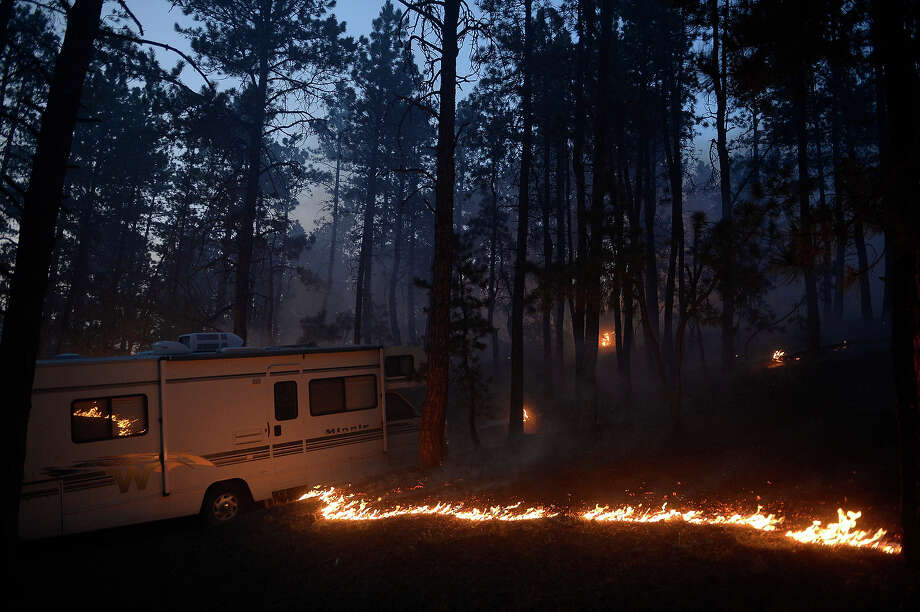 Fire runs along the bed of the forest  near a camper off of Herring Road in the Black Forest northeast of Colorado Springs, CO on June 11, 2013.  Many homes have already been lost to the raging fire that continues to burn out of control. Photo: Helen H. Richardson, Denver Post Via Getty Images / Copyright - 2013 The Denver Post, MediaNews Group.