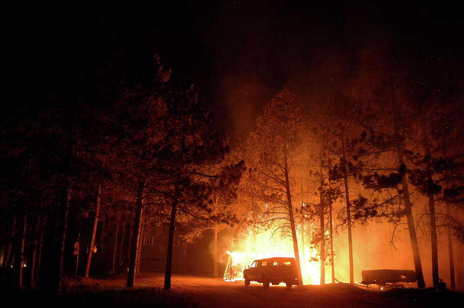 Cars and property burn out of control  along Herring Road in the midst of the Black Forest Fire northeast of Colorado Springs, CO on June 11, 2013.  Many homes have already been lost to the raging fire that continues to burn out of control. Photo: Helen H. Richardson, Denver Post Via Getty Images / Copyright - 2013 The Denver Post, MediaNews Group.