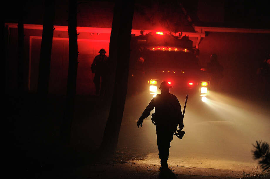 Firefighters from Black Forest Fire Department race toward a home along  Herring Road  to try to save what they can during the Black Forest Fire northeast of Colorado Springs, CO on June 11, 2013.  Many homes have already been lost to the raging fire that continues to burn out of control. Photo: Helen H. Richardson, Denver Post Via Getty Images / Copyright - 2013 The Denver Post, MediaNews Group.