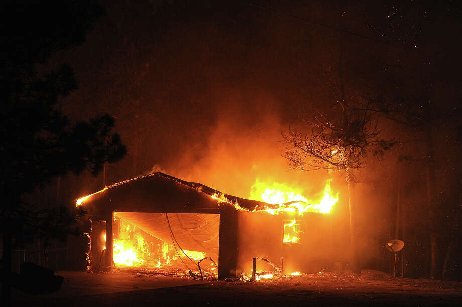 A garage along Herring road is fully involved  during the Black Forest Fire northeast of Colorado Springs, CO on June 11, 2013.  Many homes have already been lost to the raging fire that continues to burn out of control. Photo: Helen H. Richardson, Denver Post Via Getty Images / Copyright - 2013 The Denver Post, MediaNews Group.