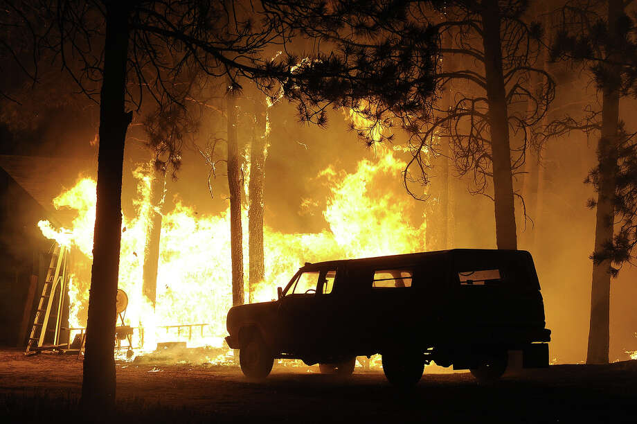 A garage is fully engulfed in flames as the Black Forest Fire continues to burn out of control northeast of Colorado Springs, CO on June 11, 2013.  The fire started around 2:00 in the Black Forest northeast of Colorado Springs, CO on June 11, 2013.  Many homes have already burned and the fire remains out of control. Photo: Helen H. Richardson, Denver Post Via Getty Images / Copyright - 2013 The Denver Post, MediaNews Group.