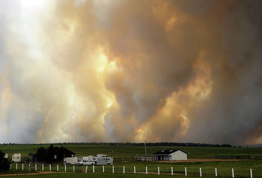 Smoke rises into the air from the Black Forest Fire June 12, 2013 near Colorado Springs, Colorado. The fire has reportedly burned 80 to 100 homes and has charred at least 8,000 acres. Photo: Chris Schneider, Getty Images / 2013 Getty Images