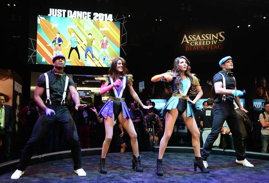 "Dancers makes their moves to the ""Just Dance 2014"" game by Ubisoft on the first day of the Electronic Entertainment Expo (E3) in Los Angeles, California, June 11, 2013.   The Electronic Entertainment Expo (E3), an annual trade fair for the computer and video games industry, runs from June 11-13. Photo: ROBYN BECK, AFP/Getty Images / 2013 AFP"
