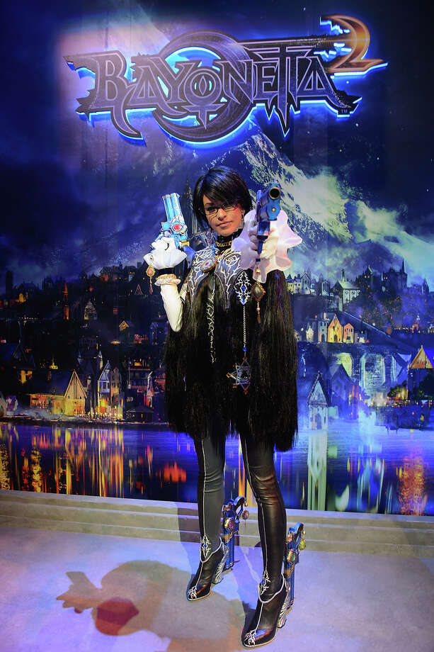 A model poses to promote Bayonetta 2 during the 2013 E3 Electronic Entertainment Expo at Los Angeles Convention Center on June 11, 2013 in Los Angeles, California. Photo: Daniel Boczarski, WireImage / 2013 Daniel Boczarski