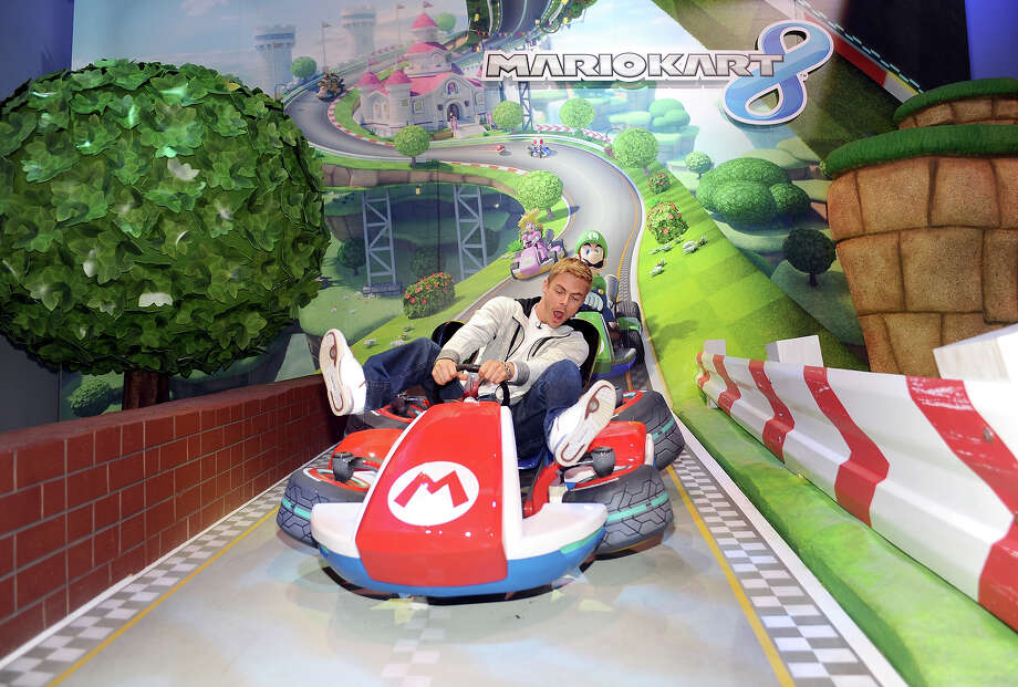 TV personality Derek Hough visits the world of Mario Kart 8 available for Wii U in December while attending Nintendo's booth at the 2013 E3 Gaming Convention at Los Angeles Convention Center on June 12, 2013 in Los Angeles, California. Photo: Stefanie Keenan / 2013 Stefanie Keenan