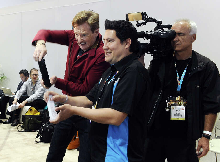 Conan O'Brien (L) gets an exclusive look at the brand new Mario Kart 8 for Wii U while attending Nintendo's booth at the 2013 E3 Gaming Convention at Los Angeles Convention Center on June 12, 2013 in Los Angeles, California. Photo: Stefanie Keenan / 2013 Stefanie Keenan