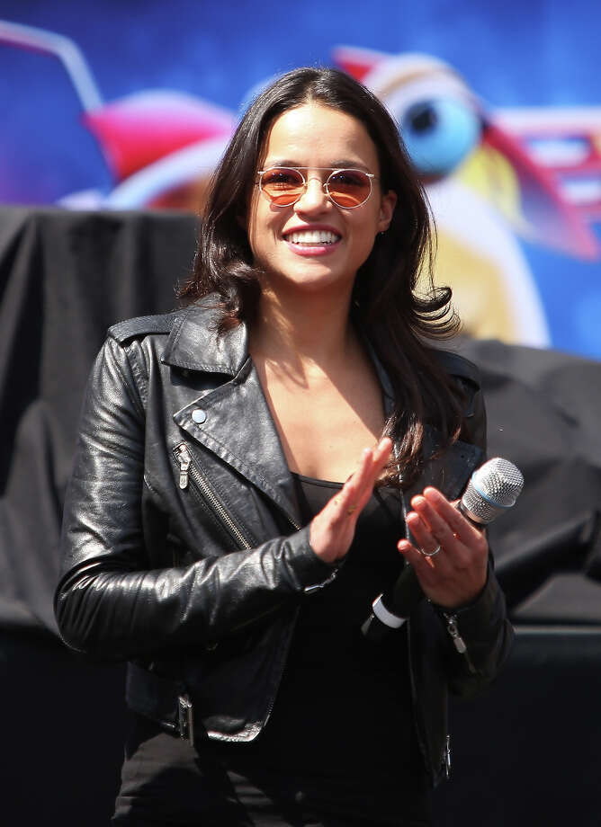 "Michelle Rodriguez speaks onstage at the ""Turbo"" party and pop-up concert during E3 gaming convention held at Nokia Theatre L.A. Live Plaza on June 12, 2013 in Los Angeles, California. Photo: Michael Tran, FilmMagic / 2013 Michael Tran"