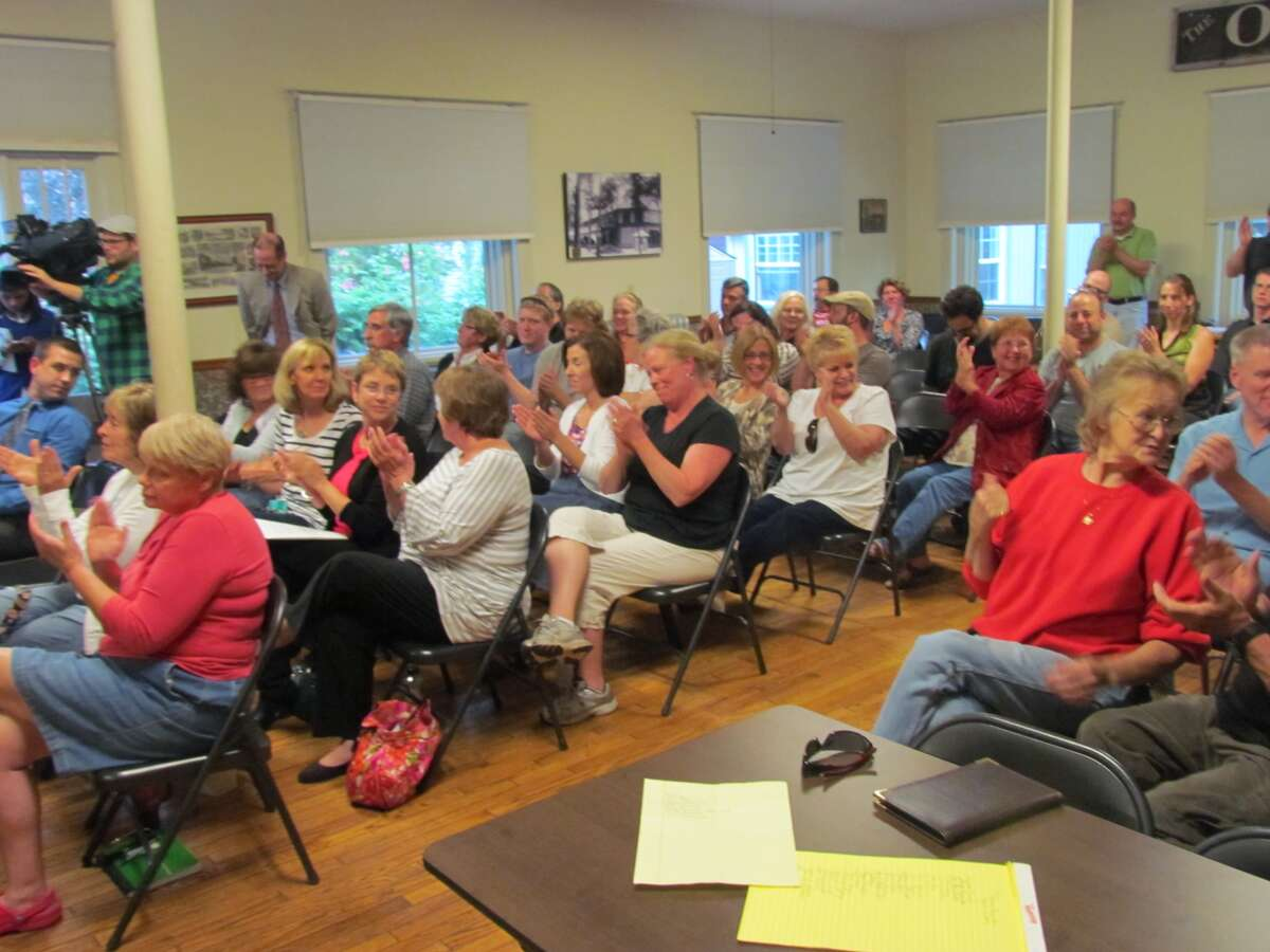 Residents applaud after the newly appointed Round Lake Library Board of Trustees votedWednesday, June 12, 2013,to reinstate Theresa Marchione to her position at the library. (Paul Block / Times Union)