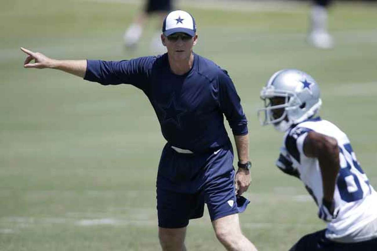 Dallas Cowboys head coach Jason Garrett instructs wide receiver Jared Green (85) during workouts at an NFL football minicamp practice Tuesday, June 11, 2013, in Irving, Texas. (AP Photo/Tony Gutierrez)