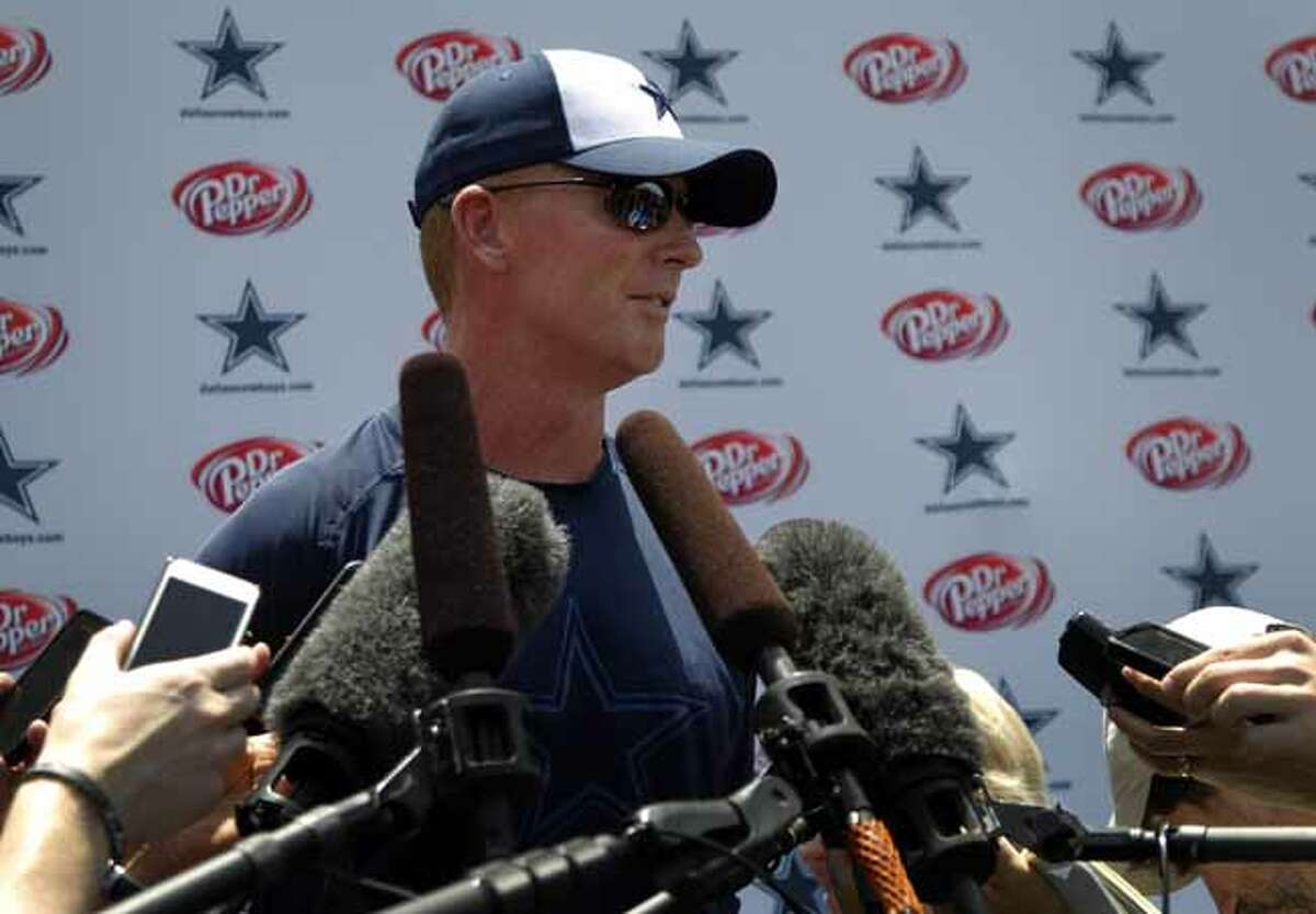 Dallas Cowboys head coach Jason Garrett responds to questions at a news conference following a workout at their NFL football minicamp on Wednesday, June 12, 2013, in Irving, Texas. (AP Photo/Tony Gutierrez)