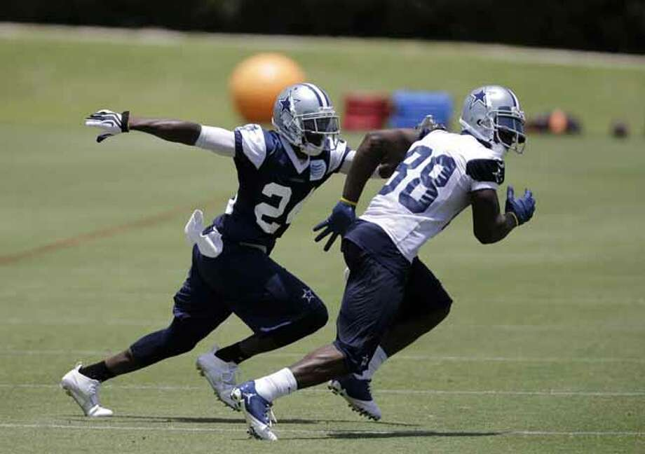 Dallas Cowboys cornerback Morris Claiborne (24) defends as wide receiver Dez Bryant (88) runs a route in drills during their NFL football minicamp on Wednesday, June 12, 2013, in Irving, Texas. (AP Photo/Tony Gutierrez) Photo: Tony Gutierrez, Associated Press / AP