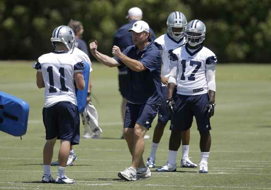 Dallas Cowboys linebackers coach Matt Eberflus, center, instructs Cole Beasley (11) and Dwayne Harris (17) as the team runs drills during their NFL football minicamp on Tuesday, June 11, 2013, in Irving, Texas. (AP Photo/Tony Gutierrez) Photo: Tony Gutierrez, Associated Press / AP