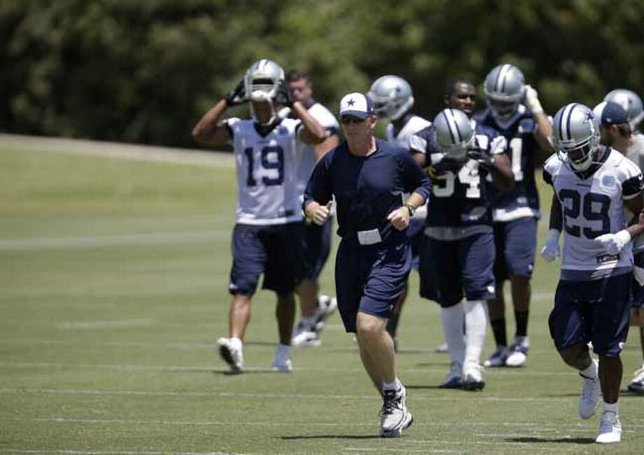 Dallas Cowboys head coach Jason Garrett runs up field with his team during their NFL football minicamp on Tuesday, June 11, 2013, in Irving, Texas. (AP Photo/Tony Gutierrez) Photo: Tony Gutierrez, Associated Press / AP
