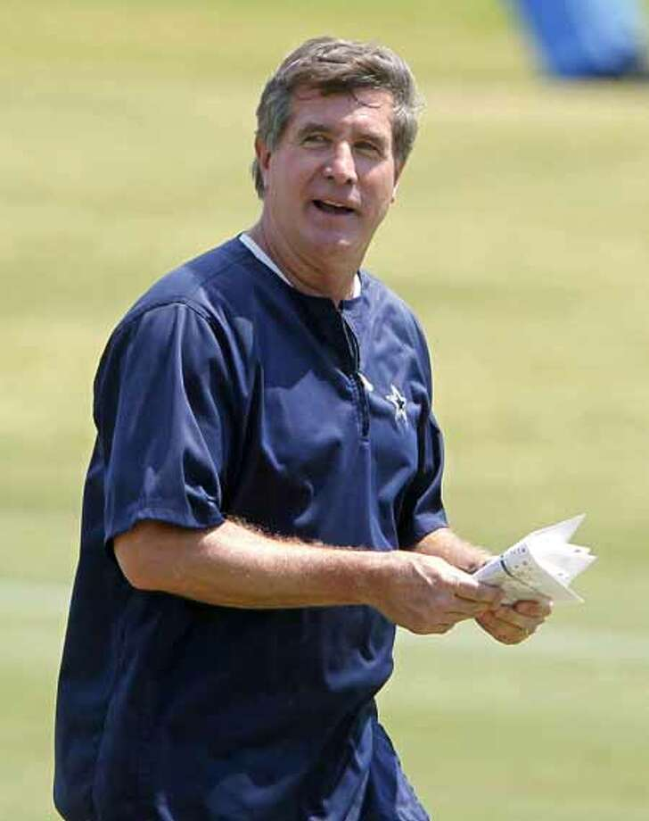Dallas Cowboys offensive coordinator/offensive line coach Bill Callahan watches the NFL football team's practice in Irving, Texas, Tuesday, June 4, 2013. Callahan will call the plays for the Cowboys in 2013. So says owner Jerry Jones, and even Callahan confirmed it. Just don't expect acknowledgement soon from coach Jason Garrett, the play-caller since joining the staff in 2007. (AP Photo/Fort Worth Star-Telegram, Ron Jenkins) MAGS OUT (FORT WORTH WEEKLY, 360 WEST); INTERNET OUT Photo: Ron Jenkins, Associated Press / Fort Worth Star-Telegram