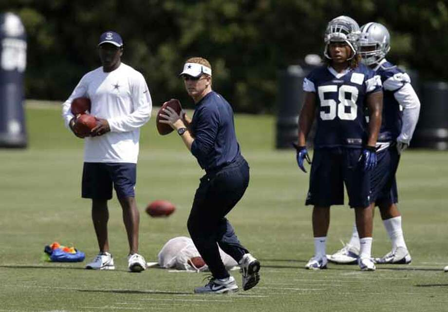 Dallas Cowboys head coach Jason Garrett runs drills during an organized team activity Tuesday, June 4, 2013, in Irving, Texas. (AP Photo/Tony Gutierrez) Photo: Tony Gutierrez, Associated Press / AP
