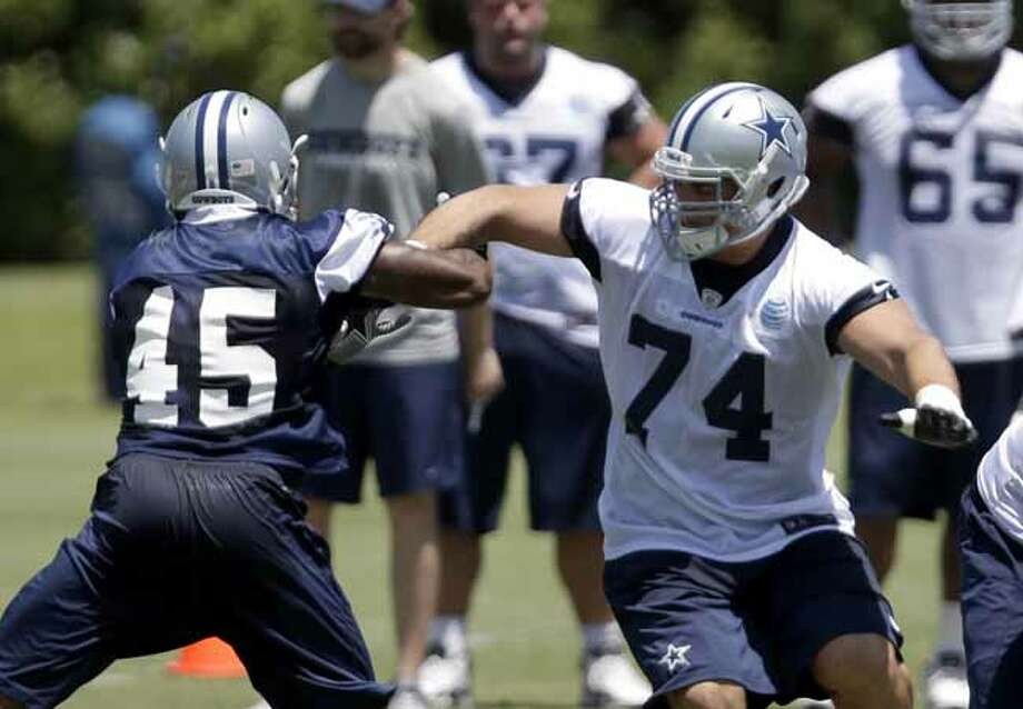 Dallas Cowboys linebacker Deon Lacey (45) pressures tackle J.B. Shugarts (74) as the team runs plays during their NFL football minicamp on Tuesday, June 11, 2013, in Irving, Texas. (AP Photo/Tony Gutierrez) Photo: Tony Gutierrez, Associated Press / AP
