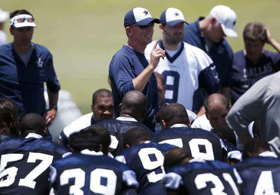 Dallas Cowboys head coach Jason Garrett, center, addresses the team at the end of workouts during NFL football minicamp Tuesday, June 11, 2013, in Irving, Texas. (AP Photo/Tony Gutierrez) Photo: Tony Gutierrez, Associated Press / AP