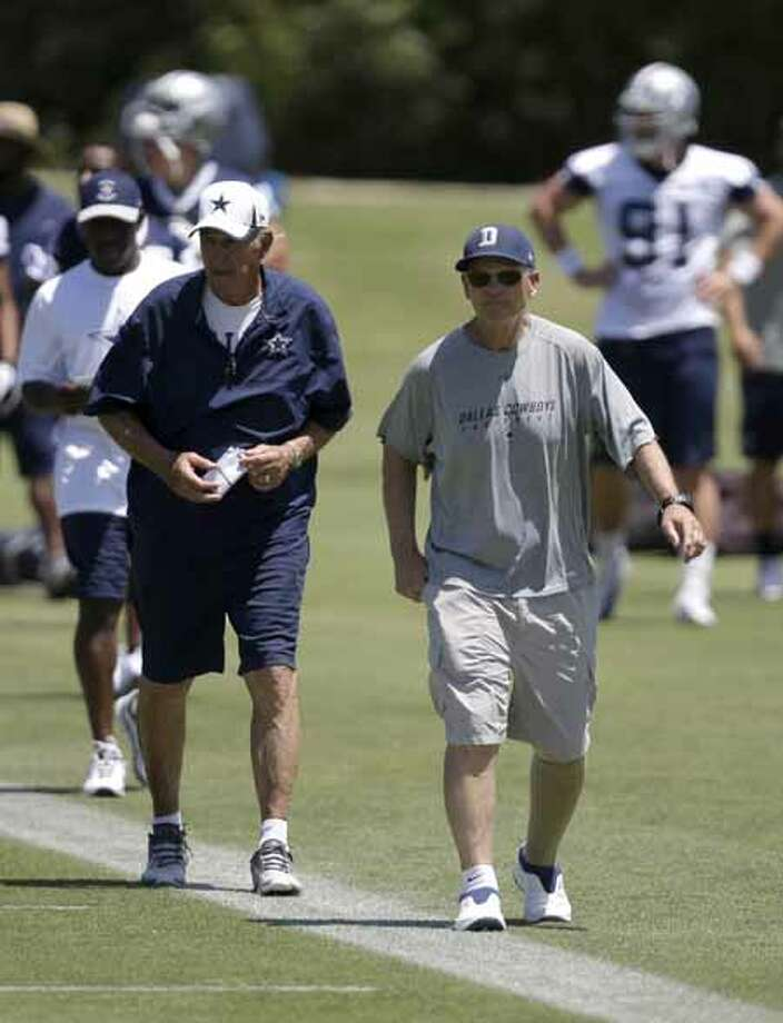 Dallas Cowboys defensive coordinator Monte Kiffin, left, and defensive line coach Rod Marinelli, right, watch as the team runs plays during their NFL football minicamp on Tuesday, June 11, 2013, in Irving, Texas. (AP Photo/Tony Gutierrez) Photo: Tony Gutierrez, Associated Press / AP