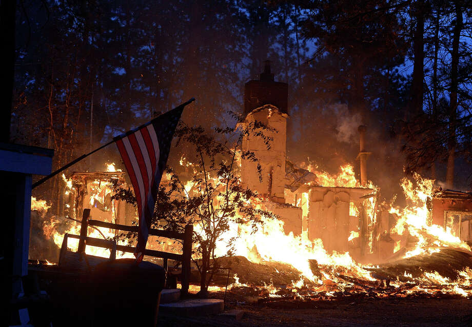 A house is fully engulfed in flames in the midst of the Black Forest Fire northeast of Colorado Springs on Wednesday, June 12, 2013. The Black Forest Fire northeast of Colorado Springs earlier prompted evacuation orders and pre-evacuation notices to more than 9,000 people and to about 3,500 homes and businesses, sheriff's officials said. The fire has destroyed at least 92 homes. (AP Photo/The Denver Post, Helen H. Richardson) MAGS OUT; TV OUT; INTERNET OUT; NO SALES; NEW YORK POST OUT; NEW YORK DAILY NEWS OUT. MANDATORY CREDIT Photo: Helen H. Richardson, AP / THE DENVER POST