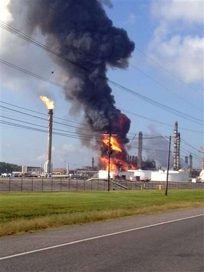 This photo shows an explosion at The Williams Companies Inc. plant in the Ascension Parish town of Geismar La., Thursday, June 13, 2013. The fire broke out Thursday morning at the plant, which the company's website says puts out about 1.3 billion pounds of ethylene and 90 million pounds of polymer grade propylene a year. Photo: Ryan Meador, AP / AP