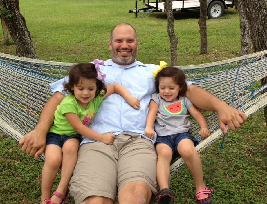 My husband is not only HOT as in mucho caliente...he is a spectacular father to our three children.  He consistently rearranges his work schedule in order to be involved with our son's baseball practices and games.  He also spends a great deal of time with our identical twin girls.  I am so lucky and proud to have this wonderful, compassionate, honorable hottie for a husband, best friend, and father of my children!