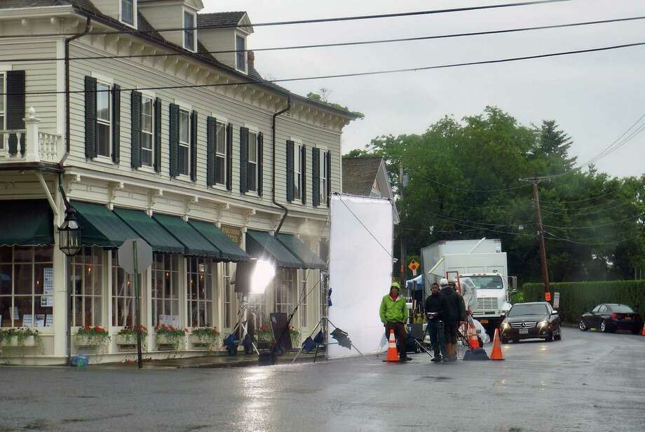 "Shooting for the movie, ""And So It Goes,"" starring Diane Keaton and Michael Douglas, went on despite the rain Thursday in the town's Southport section. Photo: Genevieve Reilly / Fairfield Citizen"
