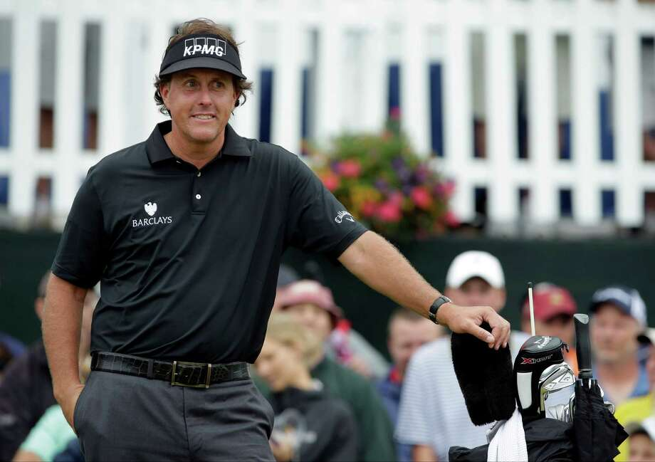 Phil Mickelson smiles as he waits for play to resume after a weather delay during the first round of the U.S. Open golf tournament at Merion Golf Club, Thursday, June 13, 2013, in Ardmore, Pa. (AP Photo/Charlie Riedel) Photo: Charlie Riedel, Associated Press / AP