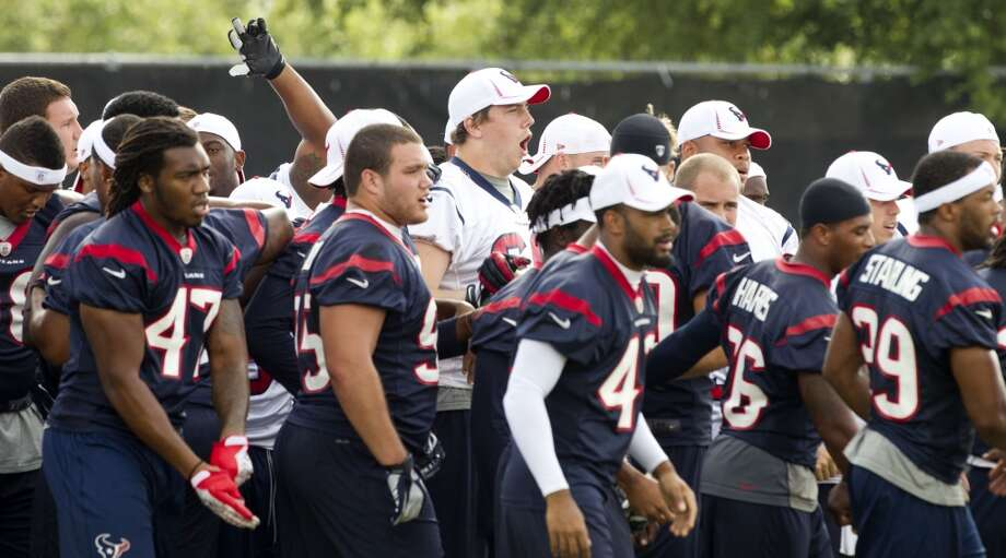 Texans players gather during the last day of minicamp. Photo: Brett Coomer, Houston Chronicle