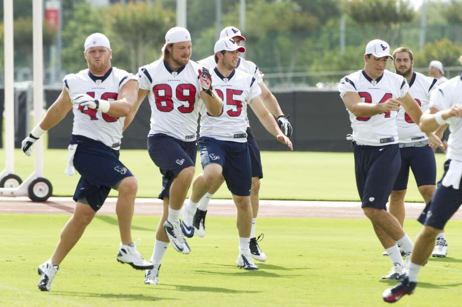 Texans players loosen up during a minicamp practice. Photo: Brett Coomer, Houston Chronicle