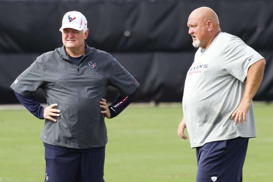 Texanx defensive coordinator Wade Phillips and Reggie Herring watch minicamp practice. Photo: Brett Coomer, Houston Chronicle