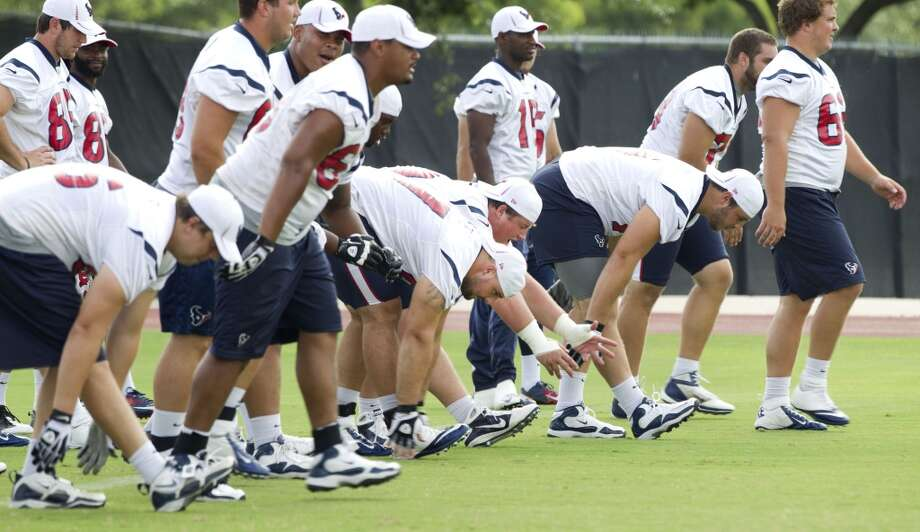 Players warm up at Texans practice. Photo: Brett Coomer, Houston Chronicle