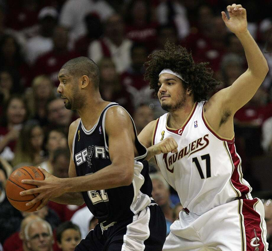 Spurs forward Tim Duncan (21) looks for room around Cavaliers forward Anderson Varejao (17) during Game 3 in the NBA Finals at the Quicken Loans Arena on June 12, 2007, in Cleveland.