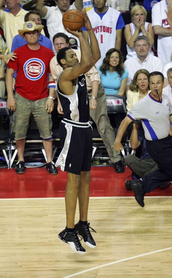 The Spurs' Robert Horry gets set to launch the game-winning 3-pointer during overtime of Game g in the NBA Finals at The Palace of Auburn Hills on June 19, 2005.