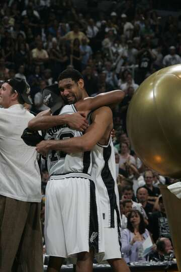 Tim Duncan and Bruce Bowen embrace during the postgame celebration after Game 7 of the NBA Finals at