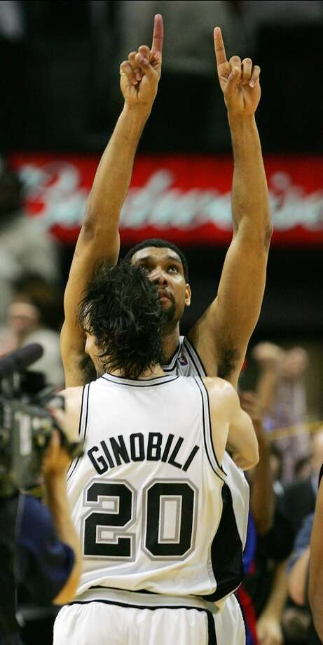 Tim Duncan and Manu Ginobili celebrate their NBA Championship following their 81-74 game 7 win over the Pistons during the NBA Finals at the SBC Center in San Antonio, June 23, 2005.