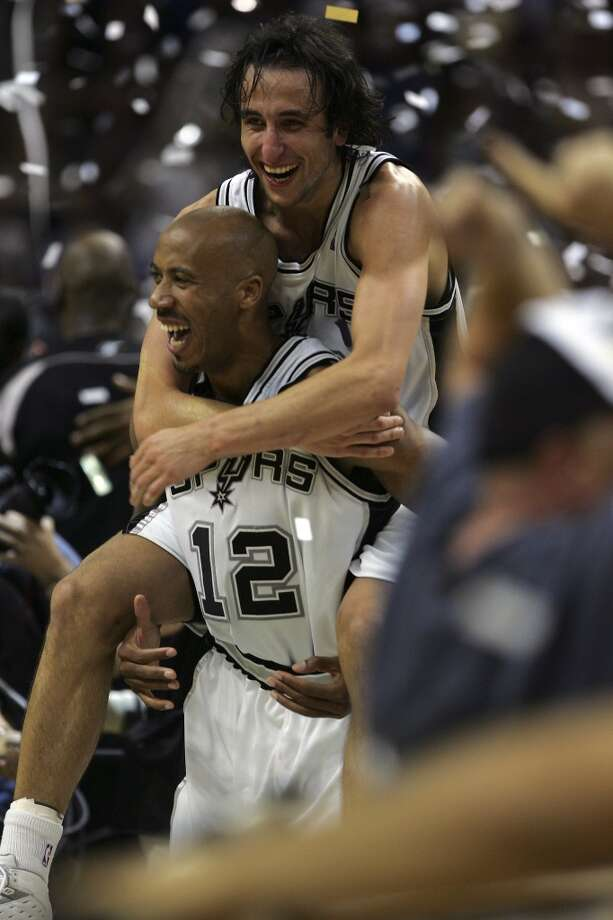 Manu Ginobili jumps on Bruce Bowen at the end of Game 7 of the NBA Finals at the SBC Center in San Antonio, June 23, 2005.