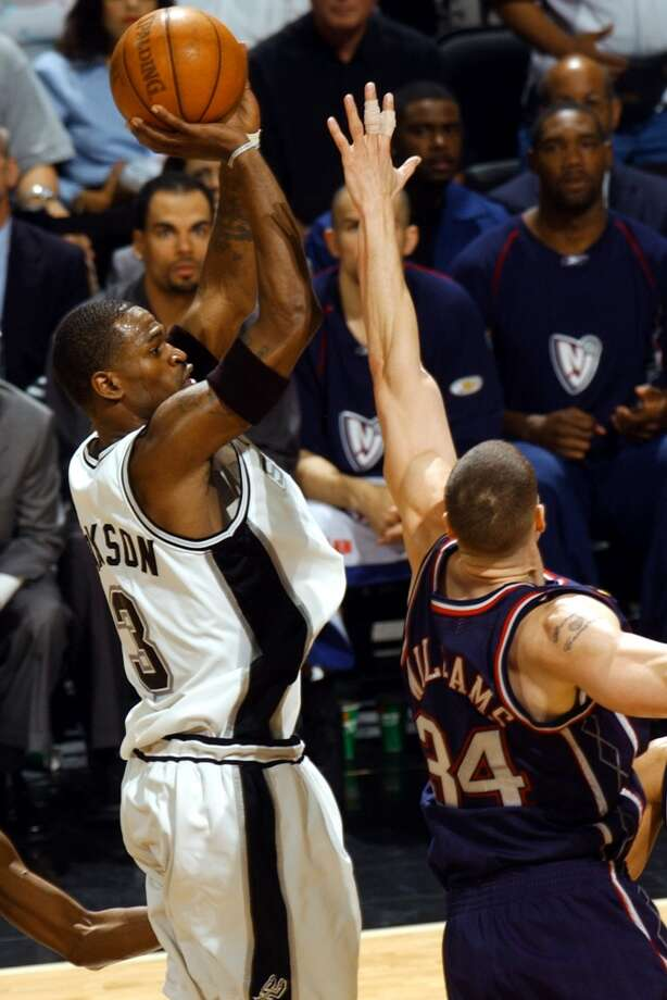 The Spurs' Stephen Jackson shoots over the Nets' Aaron Williams during second quarter action of Game 6 NBA Finals at the SBC Center in San Antonio on June 15, 2003. Jackson made an impact for the Spurs but had a long and winding career after that.
