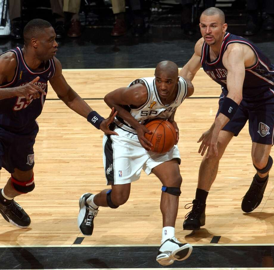 The Spurs' Speedy Claxton dribbles through  Nets' Dikembe Mutombo (left) and Jason Kidd during Game 6 NBA Finals at the SBC Center on  June 15, 2003. Claxton only spent a short time with the Spurs but came through in the 2003 playoffs.